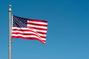 American flag blowing in the wind photo