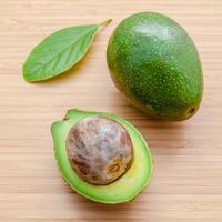 Fresh avocado on wooden background