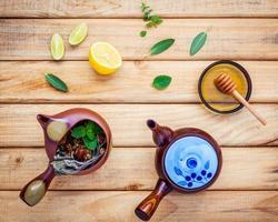 Top view of herbal tea on wood photo