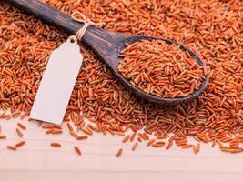 Whole grain rice in a spoon photo
