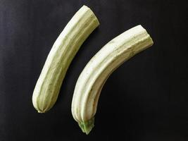 Zucchinis on a dark table background