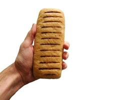 Hand holding a load of bread on a white background