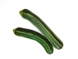 Two zucchinis on a white background