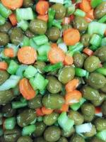 Close-up of olives, celery, and carrots