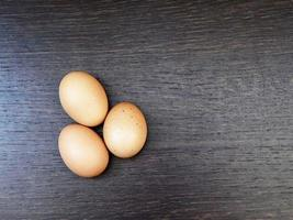 Brown eggs on a dark wood table background