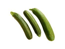 Three zucchinis on a white background