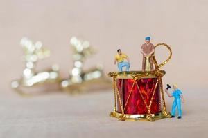 Miniature workers working on Christmas decorations, Christmas and Happy New Year concept photo