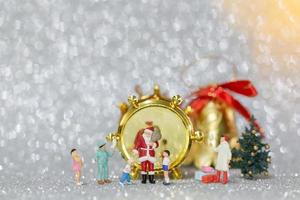Miniature happy family celebrating Christmas, X-mas and Happy New Year concept