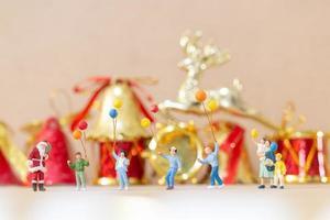 Miniature happy family celebrating Christmas, X-mas and Happy New Year concept photo