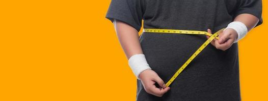 Man measuring waist photo