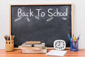 Back to school and education concept on blackboard photo