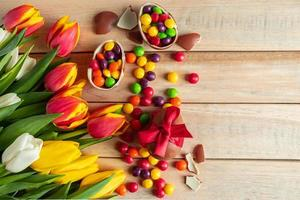 Multi-colored tulips and chocolate Easter eggs