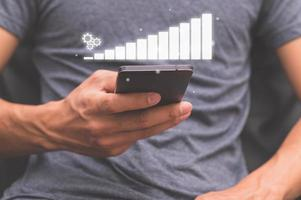 Business people use smartphones to show business growth graph