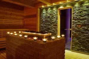 Modern sauna with candles and stone interior