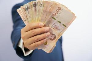 Business man holding Thai money