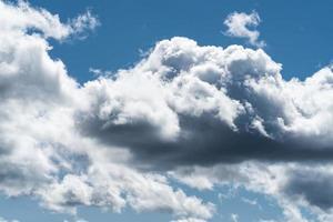 Cumulus clouds in a blue sky photo