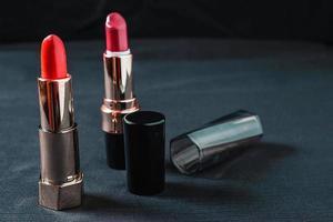 Tubes of lipstick on a black cloth