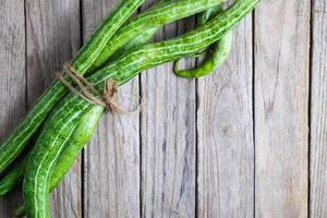 Zucchini bundled with twine on a wooden background
