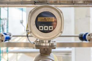 Flow meter system on factory pipeline photo
