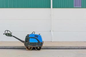 Asphalting roller at work at a road construction photo