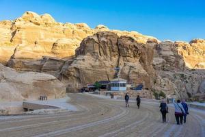 Tourists in narrow passage of rocks of Petra canyon in Jordan, 2018