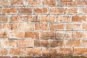 viejo muro de ladrillo degradado foto