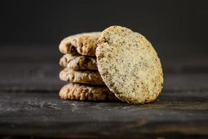 Pile of cookies on wooden table