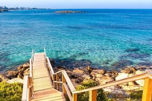 Wooden ladder to clear sea water photo