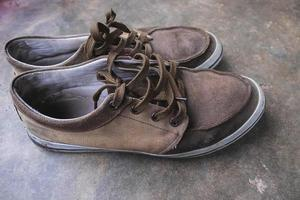 Pair of canvas shoes on a floor