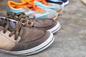 Three pairs of colorful canvas shoes on a floor