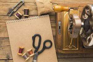 Flat lay of a sewing machine and items photo