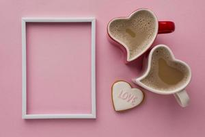 Coffee and picture frame on pink