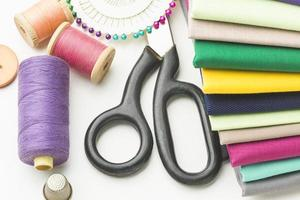 Sewing items on white photo