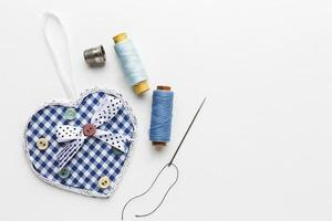 Sewing items with checkered heart photo