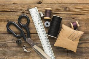 Top view of sewing items on wood photo