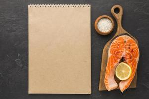 Empty notebook and salmon