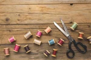 Thread and scissors on a table photo