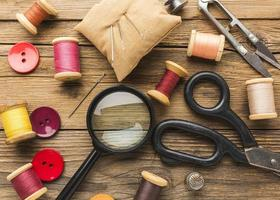Flat lay of sewing items on a desk photo