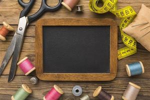 Chalkboard with sewing items photo