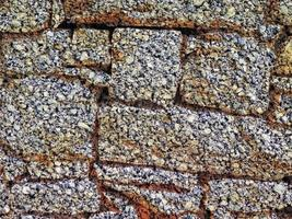 Detail of outdoor stone wall for background or texture
