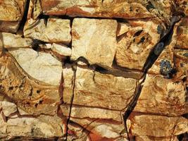 Detalle de la pared de piedra al aire libre para el fondo o la textura foto