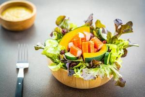 Crab sticks with fresh vegetable salad with mayonnaise sauce photo