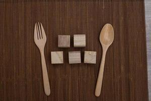 Wooden blocks and flatware photo