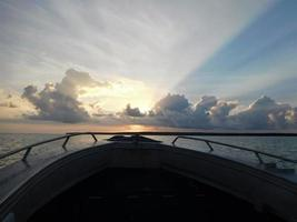 View from the bow of the boat during sunrise in Tiwi Islands Australia photo