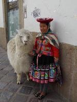 Peru 2015--Woman with her alpaca photo