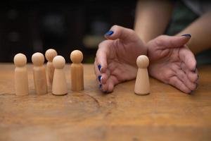 Person hands with wooden figurines photo