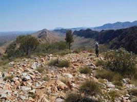 Australia 2015--A trekker taking photos of Larapinta Track in central Australia