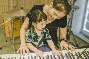 Girl learning how to play piano