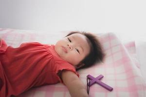 Newborn girl with a cross