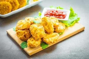 Deep fried chicken nuggets with ketchup